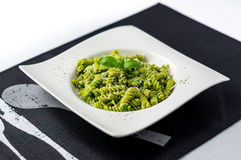Basil pesto pasta salad. Rotini pasta with basil pesto sauce, grated parmesan cheese and fresh pepper. This Italian dish makes a delicious meal by itself or stock images