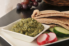 Basil pesto with pita bread Royalty Free Stock Images