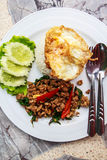 Basil pig and fried eggs. Stock Image