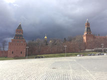 Basil`s Descent and Kremlin Wall, Moscow. View to Moscow Kremlin wall from Basil`s Descent in a cloudy day. Moscow. Russia Stock Photo