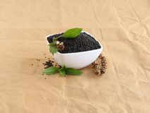 Basil Seeds in a Bowl and Leaves and Dry Pistil. Basil seeds, also known as sabja seeds, are a healthy food, leaves and dry pistil, in a bowl and on it is a stock photo