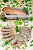 Basil sourdough bread. On a wooden board royalty free stock photos