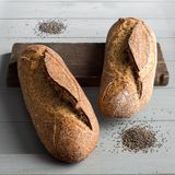 Basil sourdough bread. On a wooden board stock photo