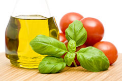 Basil, tomatoes and olive oil Royalty Free Stock Photos