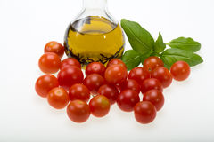 Basil, tomatoes and olive oil Royalty Free Stock Image