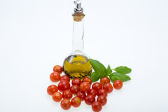 Basil, tomatoes and olive oil Stock Photo