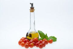 Basil, tomatoes and olive oil Royalty Free Stock Photo