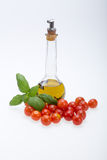 Basil, tomatoes and olive oil Royalty Free Stock Images