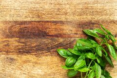 Free Basil Twig On A Vintage Wood Chopping Board. Flat Lay, Top View With Copy Space Royalty Free Stock Image - 206668246