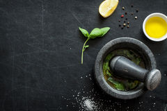 Basil vinaigrette dressing - recipe ingredients on black Royalty Free Stock Images