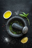 Basil vinaigrette dressing - recipe ingredients on black chalkboard Stock Image
