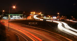 Basildon, Essex, UK - February 12, 2012: Night tim. Lanes of busy traffic flowing in both directions at a busy roundabout on the A127, near Laindon, Essex, UK Stock Photos