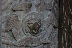 Basilica of Alberobello. Bas-relief. Basilica of Alberobello. Raptor bronze bas-relief detail Stock Images