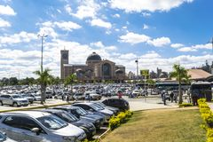 Aparecida cathedral in Sao Paulo, Brazil - National Shrine. APARECIDA, SAO PAULO - BRAZIL - AUG 6, 2017: Parking of the Basilica of the National Shrine of stock photography