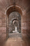 Basilica of Bom Jesus corridor. Basilica of Bom Jesus Church empty corridor with brick walls and arches in Panaji, Old Goa, India Royalty Free Stock Photography
