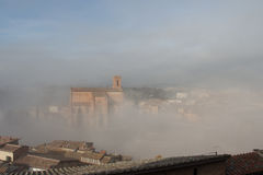 Basilica Cateriniana or Basilica of San Domenico in the thick fog, Siena, Tuscany, Italy. royalty free stock photos