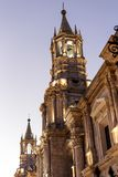 The Basilica Cathedral of Arequipa with flags, Backlight, Peru royalty free stock photos