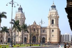 The Basilica Cathedral of Lima on Plaza Mayor Square with many Tourist, Lima, Peru. South America architecture beautiful belfry bell bench blue building car royalty free stock photo