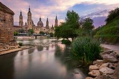 Basilica de Nuestra Senora del Pilar and Ebor River in the Evening, Zaragoza, Aragon, Spain stock images