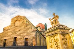 Basilica di San Lorenzo Cappelle Medicee chapel and Giovanni delle Bande Nere monument on Piazza di San Lorenzo square in historic. Al centre of Florence city royalty free stock photos