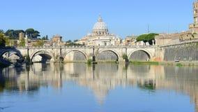 Basilica di San Pietro over Sant Angelo bridge on Tevere river. Basilica of San Pietro overlooking the Tevere river and surrounding historical landmarks of Rome Stock Image