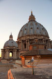 Basilica di San Pietro in Vaticano at sunset Stock Image