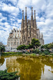 Basilica and Expiatory Church of the Holy Family by Gaudi. BARCELONA, SPAIN - MAY 17, 2014: Basilica and Expiatory Church of the Holy Family by Gaudi, building Royalty Free Stock Images