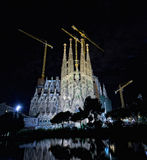 Basilica of La Sagrada Familia at night. The Basilica of La Sagrada Familia at night. Designed by Antoni Gaudi, its construction began in 1882 and is not Royalty Free Stock Photography
