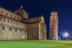 Basilica and the leaning tower in Pisa Italy. Architecture background Stock Photos