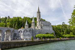 The Basilica of Lourdes at Gave de Pau river Stock Photos
