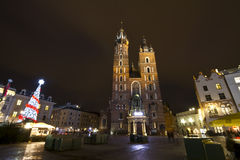 Basilica Mariacka on Market place at christmastime in Krakow Royalty Free Stock Photos