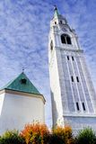 Tower of Parish Church Santi Filippo e Giacomo Apostoli in Cortina d`Ampezzo. Basilica Minore dei Santi Filippo e Giacomo is a Roman Catholic basilica located in royalty free stock image