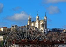Basilica of Notre-Dame de Fourviere of Virgin Mary with Ferris wheel, landmarks of Lyon and Fourviere hill, France stock images