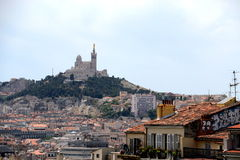 Basilica Notre-Dame de la Garde. Marseille, France - May 28, 2015: Basilica Notre-Dame de la Garde viewed from Saint-Charles station royalty free stock photos