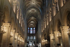 Basilica Notre Dame. Looking towards the pulpit inside Basilica Notre Dame—located in the first district of Paris, this is one of the city`s most famous stock images
