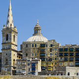 Basilica of Our Lady on Malta. Cityscape view with Basilica of Our Lady of Mount Carmel on the island of Malta. Buildings with traditional colorful maltese Royalty Free Stock Photography