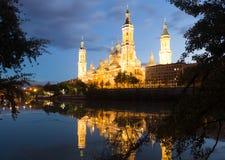 Basilica of Our Lady of the Pillar in dusk. Zaragoza Stock Photos