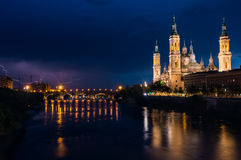 Basilica of Our Lady of the Pillar. And Ebro River, Zaragoza, Aragon, Spain. Lighting storm Royalty Free Stock Image