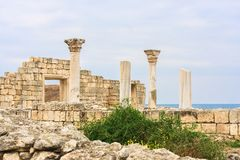 Basilica in the ruins of ancient Greek city of Chersonesus Taurica in the Crimea peninsula under the cloudy sky Royalty Free Stock Photos