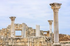 Basilica in the ruins of ancient Greek city of Chersonesus Taurica in the Crimea peninsula under the cloudy sky Stock Images