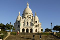 Basilica Sacré-Coeur Paris. Basilica Sacré-Coeur of Paris with stairs in the  foreground. Blue sky Royalty Free Stock Photography