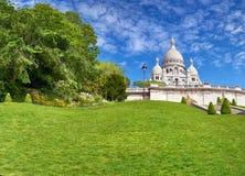 Basilica of Sacre-Coeur in Montmartre, Paris. Basilica of Sacre-Coeur in Montmartre in Paris in springtime, panoramic image Royalty Free Stock Photo