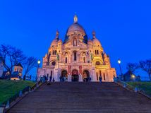 Basilica of Sacre Coeur in Montmartre in Paris France at twiligh. Illuminated Basilica of Sacre Coeur in Montmartre in Paris, France at sunset Royalty Free Stock Photos