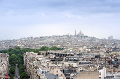 Basilica Sacre Coeur in montmartre with paris skyline Royalty Free Stock Photo