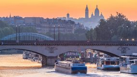 Basilica Sacre Coeur and the Seine river night to day transition timelapse before sunrise, Paris, France. Morning view from Bir-Hakeim bridge with reflections stock video