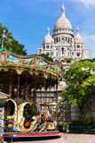 Basilica Sacre Coeur and vintage carousel on Montmartre Hill. Pa Stock Photo