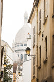 Basilica of the Sacred Heart from one of the Montmartre streets Stock Photo