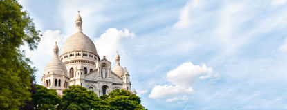 Basilica  Sacred Heart of Paris. Panoramic view of Basilica of the Sacred Heart of Paris with blue cloudy sky in background (Paris, France, Europe Royalty Free Stock Image
