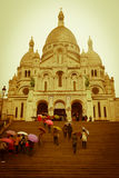 Basilica of the Sacred Heart of Paris, Paris. Montmartre is a hill in the north of Paris, France. It is 130 metres high and gives its name to the surrounding Royalty Free Stock Photography