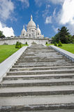 Basilica of the Sacred Heart of Paris. Sacre Coeur is a Roman Catholic church and minor basilica, dedicated to the Sacred Heart of Jesus, in Paris, France. A Stock Image